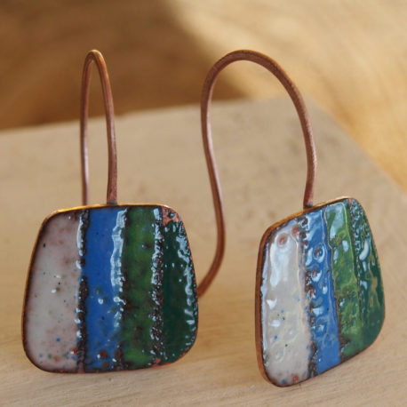 Unique handcrafted earrings. I have made these earrings on a base of copper which I have decorated with glass enamel powder before firing in the kiln at high temperature to fuse the powder to the metal. The earrings have a copper wire earpost. THe length of the earrings is 3.5cm.  The colours used in these earrings are calm creams and blue/greens