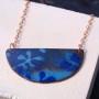 Copper enamel and rose gold half moon pendant