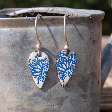 Copper enamel drop earrings with a fresh indigo blue and white floral pattern.  Beautiful summery earrings just right for garden parties or summer weddings.  The earrings are a leaf shape drop of copper with an indigo pattern over an antique white enamel base. The earrings are finished with a hand forged sterling silver ear wire.  The style is very vintage inspired.