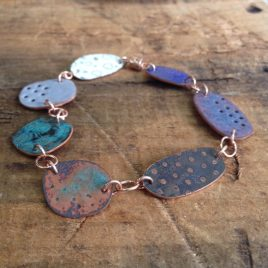Copper enamel pebble link bracelet.