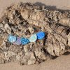 Festoon Necklace with patterned copper enamel segments