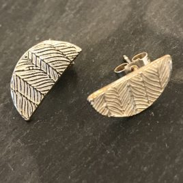 Silver half circle stud earring with chevron patterning