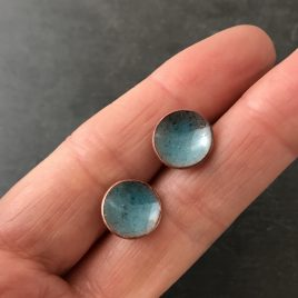 Concave copper enamel stud earrings in a deep turquoise blue colour.