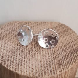These handmade stud earrings have been individually stamped with a contemporary circle polka dot pattern. Great for everyday wear and made with 100% sterling silver. These earrings are highly polished and come in a variety of patterns and shapes. The size of the silver cup is 10mm.