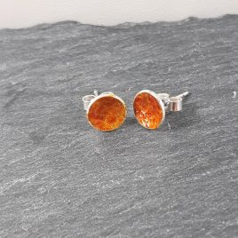 The transparent toffee coloured enamel reflects well on these sterling silver round stud earrings creating a beautiful translucent glass like appearance. These stud earrings are made with a sterling silver post and scroll back. Great earrings for wearing with jeans and white t-shirt or summer dress. All of MyCherryPie Jewellery is made by hand in Scotland and is delivered in a gift ready 100% recyclable Kraft Gift Box.