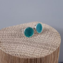 The transparent turquoise blue enamel reflects well on these sterling silver round stud earrings creating a beautiful translucent glass like appearance. These stud earrings are made with a sterling silver post and scrollback. Great earrings for wearing with jeans and white t-shirt or summer dress. All of MyCherryPie Jewellery is made by hand in Scotland and is delivered in a gift ready 100% recyclable Kraft Gift Box.