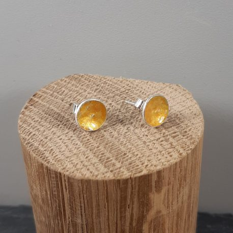 The transparent pale yellow enamel reflects well on these sterling silver round stud earrings creating a beautiful translucent glass like appearance. These stud earrings are made with a sterling silver post and scroll back. Great earrings for wearing with jeans and white t-shirt or summer dress. All of MyCherryPie Jewellery is made by hand in Scotland and is delivered in a gift ready 100% recyclable Kraft Gift Box.