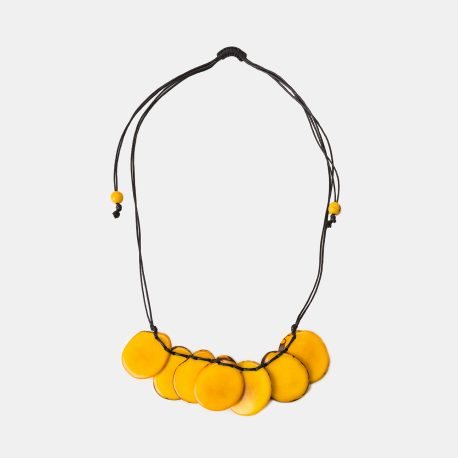 Part of the Colombia Collection, the Bogota Tagua Slice is an adjustable macrame style fastening Necklace. Seven tagua chips are clustered and intertwined with two cotton strings. Its adjustable design gives it the versatility of being worn long or short. An acai seed at each end tip provides a fun design detail. 100% organic, vegan and biodegradable Ethically made in Colombia Handmade adjustable clasp using macrame techniques, no metal in them It is approximately 42cm long at its maximum length Each piece of jewellery will arrive in a lovely eco-friendly and fair trade bag, ready to be kept safe inside or for gift giving. The package will also include care instructions and description of seeds and nuts used. Our jewellery is natural and one of a kind, they might have a slight colour, texture and size variation from the pictured piece. This makes each piece all he more unique!