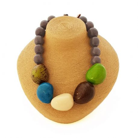 The Maceio necklace is an artistic composition of five organic tagua chunks along with some tagua bombonas to let the big bold pieces make a statement. Each of the big chunks is a single tagua nut, carved into an organic shape. A bit of the outer bark is left on some, giving a distinctive pattern to each bead. 100% organic, vegan and biodegradable Ethically made in Scotland Metal free with a handmade macrame finish 3 colour combination Length approximately 20 inches (50cm) Each piece of jewellery will arrive in a lovely eco-friendly and fair trade bag, ready to be kept safe inside or for gift giving. The package will also include care instructions and description of seeds and nuts used. Our jewellery is natural and one of a kind, they might have a slight colour, texture and size variation from the pictured piece. This makes each piece all he more unique!
