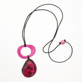 The Tupi Pendant is part of our Amazonia Collection. This is a simple and versatile tagua nut pendant made from the first slice of the nut along with a tagua chip with circular holes with some of the husk at the edges on an adjustable length japanese silk cord necklace. It fits easily over the wearer's head and can be adjusted to your preferred length. The necklace has an acai seed on the nape of the neck, which can be slid up or down to adjust its length. To tighten the necklace, just pull the two ends. 100% organic, vegan and biodegradable Ethically made in Scotland Handmade clasp using macrame techniques, no metal in them It is approximately 45cm long at its maximum length Each piece of jewellery will arrive in a lovely eco-friendly and fair trade bag, ready to be kept safe inside or for gift giving. The package will also include care instructions and description of seeds and nuts used. Our jewellery is natural and one of a kind, they might have a slight colour, texture and size variation from the pictured piece. This makes each piece all he more unique!