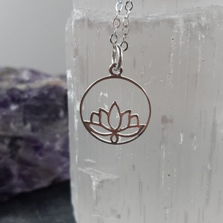 "Very elegant sterling silver lotus flower within an openwork circle creating a delicate effect. Great gift idea for yoga enthusiasts, this pendant is on an 18"" long sterling silver chain which can be layered to great effect or worn individually for a statement. The Lotus flower is regarded in many different cultures, especially in eastern religions, as a symbol of purity, enlightenment, self-regeneration and rebirth. Its characteristics are a perfect analogy for the human condition: even when its roots are in the dirtiest waters, the Lotus produces the most beautiful flower."