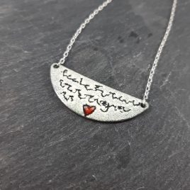 "This pendant was inspired by letters of love. It has been created using layers of kiln fired enamel through which some writing and details have been scratched, this technique is called scgraffito. The words are deliberately illegible as a love letter should always remain a secret*. The little love heart has also been highlighted with some red enamel. A truly romantic and unique piece of jewellery. The pendant is copper and the chain is sterling silver. The half moon is 45mm x 18mm and the chain is 18"" in length. All of MyCherryPie Jewellery is delivered gift ready in a 100% recyclable Kraft Gift Box. *It is possible to personalise this pendant if required."