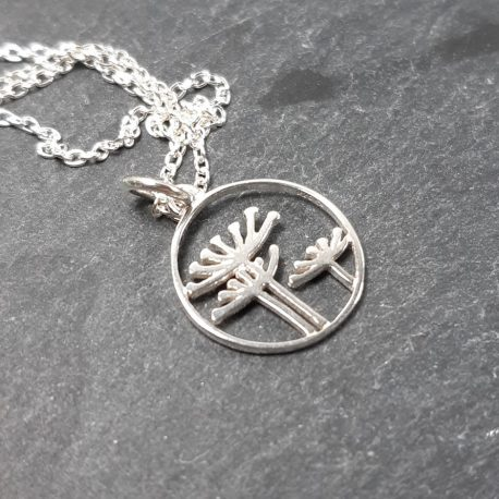 "Queen Anne's Lace sterling silver pendant on an 18"" sterling silver chain. The pendant is approximately 2cm in diameter. Lovely springtime necklace. The symbolic meaning of Queen Anne's Lace is that it represents sanctuary. It also gets the name of bishop's lace or Bird's nest due to the nest like appearance of the bright white and rounded flower when it is in full bloom."