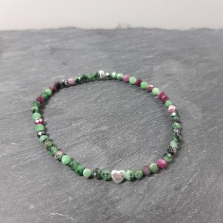 Delicate bracelet with faceted 4mm ruby zoisite gemstone and a little sterling silver heart focal bead. The various shades of green and pink in this bracelet create a unique and unusual colour palette. The bracelet is 18cm in size. Ruby in Zoisite offers the energy of happiness, appreciation, abundance, vitality and growth. It stimulates the heart and helps one to open to divine love. Zoisite helps to alleviate grief, anger, despair and defeat, and it is a powerful stone for deep healing by activating the body's defences and healing mechanisms.