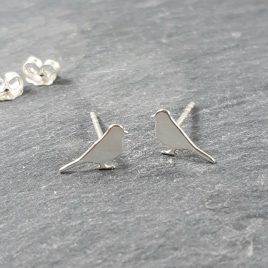 Two little birds sat singing one day …. Beautiful little sterling stud earrings. Would make a lovely springtime gift. At less than 1cm in size they would work well with multiple piercings.