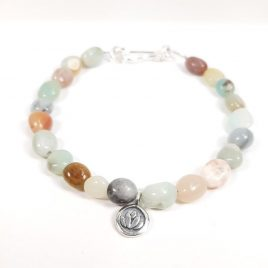Subtle mix of colours of amazonite pebble shaped gemstone bead creating a summery beach inspired piece of jewellery. I have chosen to finish this bracelet with a sterling silver lotus flower charm and clasp. The bracelet is 19cm long. Amazonite will help clear your muddled thoughts and make you better understand yourself, what's happening around you, and what your impact is to the people in your life and to the rest of the world. It's a great stone for anyone who is passionate about artistic pursuits. It can unleash the creative and imaginative side of you and help you in your projects and your artistic visions.