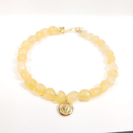 Gorgeous gemstone bracelet in a warm golden colour highlighted with gold vermeil lotus charm and hook clasp. The gemstone I chose foe this bracelet is called aragonite and the beads are pebble shaped and around 6mm in size. Such a beautiful summery sunshine bracelet to cheer up even the dullest day.