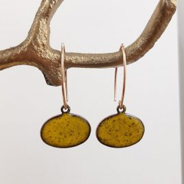 Colourful and contemporary drop earrings in a warm buttercup yellow kiln fired enamel on a shaped rose gold wire drop. The enamel is on a pebble shaped copper base and the drop of the earring is 4cm. These earrings are handmade and available in a range of colours.