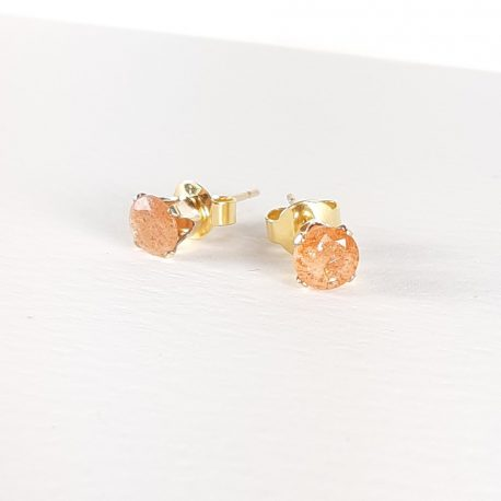 Beautifully sparkly sunstone stud earrings. These earrings are 5mm in size and the tangy orange sunstone is mounted in a gold filled claw ear post. Known as a joyful stone, Sunstone inspires the nurturing of self in order to be of service to others. It restores the enjoyment of life, good nature and provides a sense of abundance. [Hall, 283]