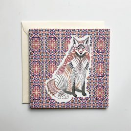Greeting card with a orange and red geometric background pattern and a geometric fox