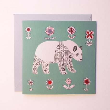 Green greeting card with a panda and geometric flowers