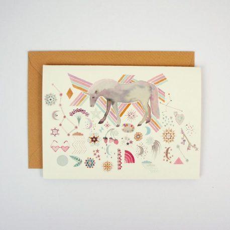 Greeting card with a unicorn illustration and rainbow stripes, moon and stars geometrics