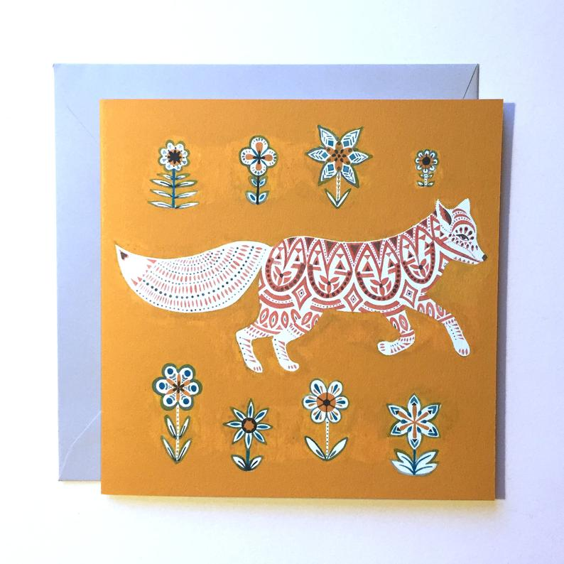 Yellow greeting card with a geometric fox on it
