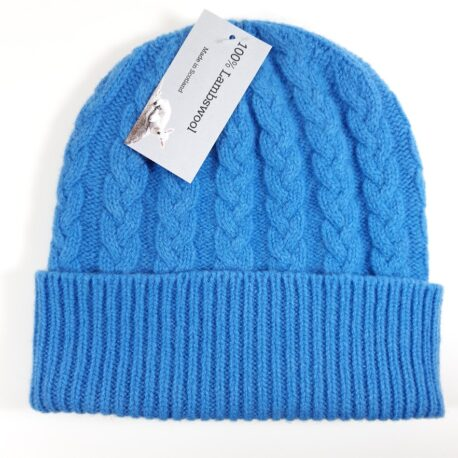 Warm and cosy knitted wool hat in 100% lambswool. Available in bright blue, denim blue, and racing green. Made in Scotland