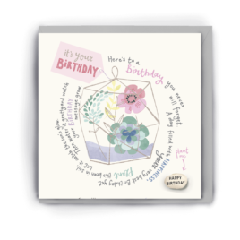 Greetings card with flowers and plants inside a terrarium in pale, pastel tones on it along with the words 'it's your birthday' and a short poem