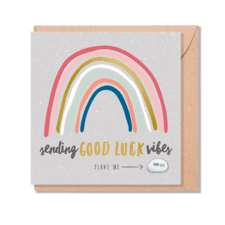 Greetings card with a colourful rainbow on it and the words 'sending good luck vibes' in a cursive font on it
