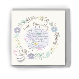 Greetings card with flowers and plants in pale, pastel tones on it along with the words 'with sympathy' and a short poem