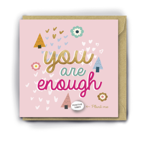 Pink card with love hearts, flowers and trees on it and the words 'you are enough' in cursive, colourful font