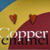 copper enamel heart studs in deep orange