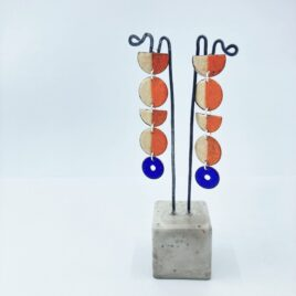 Statement circle drop earrings in orange, caramel and blue