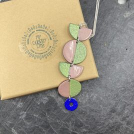 Statement circle necklace in leaf green and pink