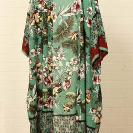 Green Floral and Leaf Print Ornate Border Kimono. Very elegant and easy to wear long line kimono in a beautiful Japanese inspired fabric. This would look amazing styled over jeans and vest, or over swimsuit, or as loungewear as a dressing gown alternative. The Garment is very soft and has a lovely drape, it is 100% viscose. The sizing is very generous and it is one size fits all.
