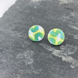 Large statement stud earrings with wavy pattern